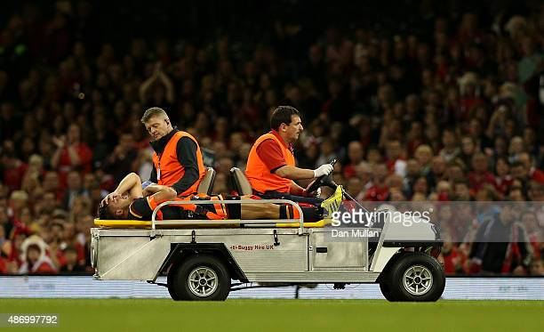 Rhys Webb of Wales is stretchered off the field after suffering a leg injury during the International Match between Wales and Italy at Millennium...