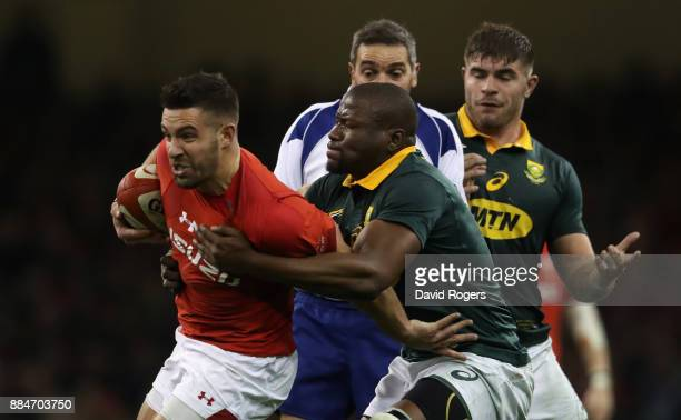 Rhys Webb of Wales is tackled by Oupa Mohoje during the rugby union international match between Wales and South Africa at the Principality Stadium on...