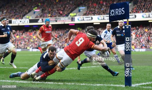 Rhys Webb of Wales is tackled into touch by Tim Visser of Scotland just short of the tryline during the RBS Six Nations match between Scotland and...