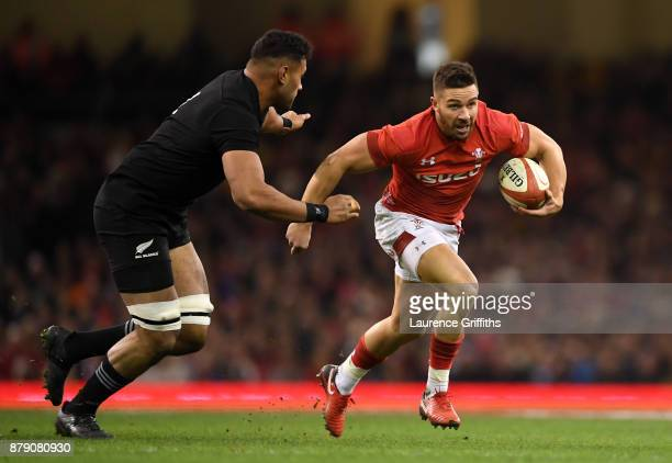 Rhys Webb of Wales runs with the ball during the International match between Wales and New Zealand at Principality Stadium on November 25 2017 in...