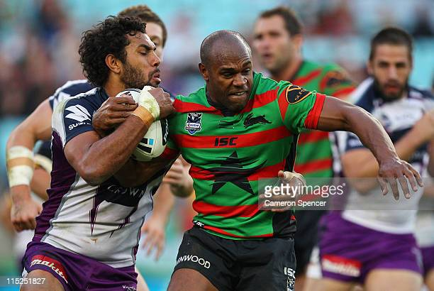 Rhys Wesser of the Rabbitohs is tackled during the round 13 NRL match between the South Sydney Rabbitohs and the Melbourne Storm at ANZ Stadium on...