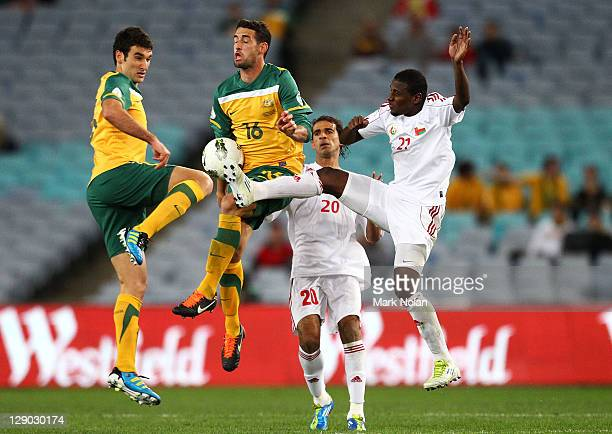 Rhys Williams and Carl Valeri of Australia and Amad Ali Sulaiman Al Honsi and Mohammed Hamed Al Makhaini of Oman contest possession during the FIFA...