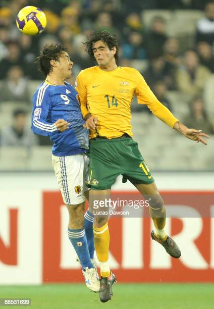 Rhys Williams of Australia heads the ball against Hideo Hashimoto of Japan during the 2010 FIFA World Cup Asian qualifying match between the...