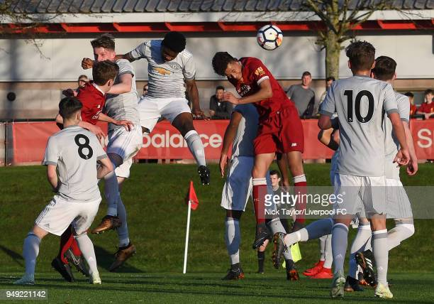 Rhys Williams of Liverpool and Ethan Laird of Manchester United compete for the ball in a crowded penalty area during the Liverpool v Manchester...