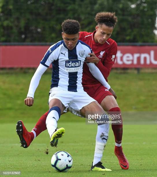 Rhys Williams of Liverpool and Morgan Rogers of West Bromwich Albion in action during the Liverpool U18 v West Bromwich Albion U18 game at The Kirkby...