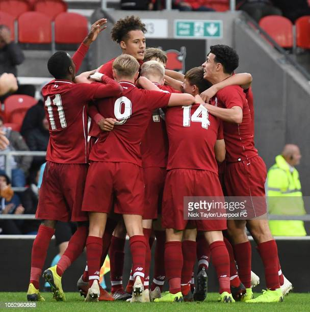 Rhys Williams of Liverpool celebrates scoring the winning goal with his team mates during the UEFA Youth League game at Langtree Park on October 24...