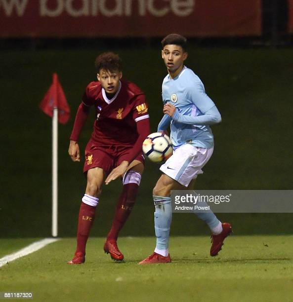 Rhys Williams of Liverpool competes with Nabil Touaizi of Manchester City during the U18 Premier League match between Liverpool U18 and Manchester...