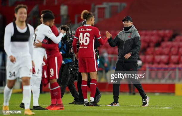 Rhys Williams of Liverpool interacts with Jurgen Klopp Manager of Liverpool after the UEFA Champions League Group D stage match between Liverpool FC...