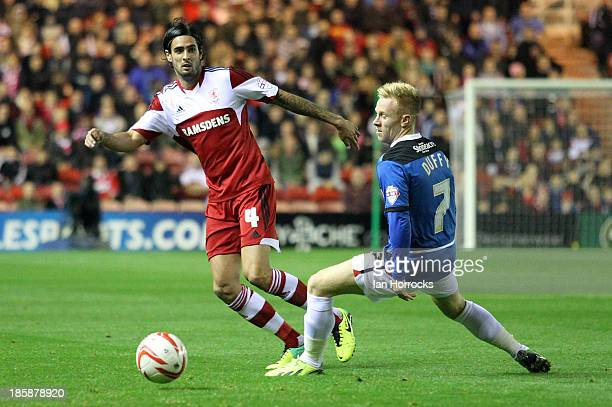 Rhys Williams of Middlesbrough is challenged by Mark Duffy of Doncaster during the Sky Bet Championship game between Middlesbrough and Doncaster...