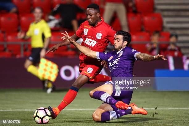 Rhys Williams of Perth Glory tackles Mark Ochieng of Adelaide United during the round 19 ALeague match between Adelaide United and Perth Glory at...