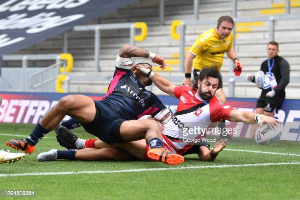 Rhys Williams of Salford Red Devils scores a try during the Betfred Super League match between Salford Red Devils and Hull FC at Emerald Headingley...