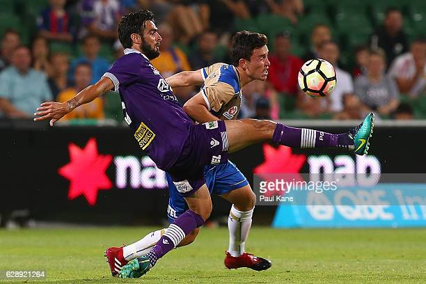 Rhys Williams of the Glory and Devante Clut of the Jets contest for the ball during the round 10 ALeague match between the Perth Glory and the...