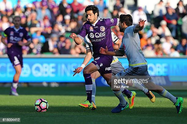 Rhys Williams of the Glory and Vince Lia of the Phoenix contest for the ball during the round two ALeague match between the Perth Glory and the...