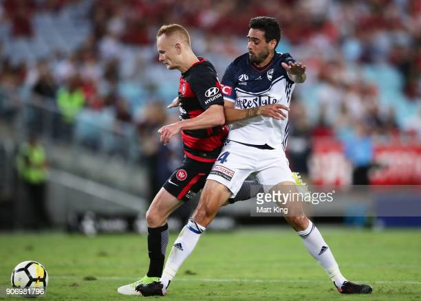 Rhys Williams of the Victory clashes with Jack Clisby of the Wanderers during the round 17 ALeague match between the Western Sydney Wanderers and the...