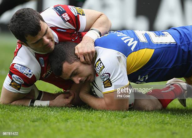 Rhys Williams of Warrington Wolves scores a try during the Engage Rugby Super League Magic Weekend match between Salford City Reds and Warrington...