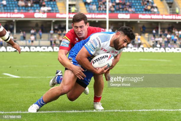 Rhyse Martin of Leeds Rhinos goes over to score their side's first try during the Betfred Super League match between Leeds Rhinos and Catalans...