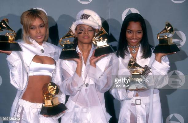 Rhythm and blues group TLC Tionne 'TBoz' Watkins Lisa 'Left Eye' Lopes and Rozonda 'Chilli' Thomas pose with their statuettes during the 38th Annual...