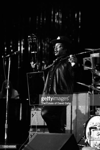 Rhythm and blues singersongwriter and guitarist Bo Diddley performs in November 1972 at Hofstra University in New York City New York