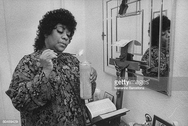 Rhythm blues singer Ruth Brown famous in the '50's now enjoying her comeback seen at home lighting candle in remembrance of late friend Jackie Wilson...