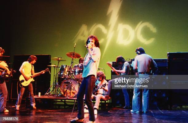 Rhythm guitarist Malcolm Young drummer Phil Rudd singer Bon Scott lead guitarist Angus Young and bassist Mark Evans of AC/DC rehearse for a gig circa...