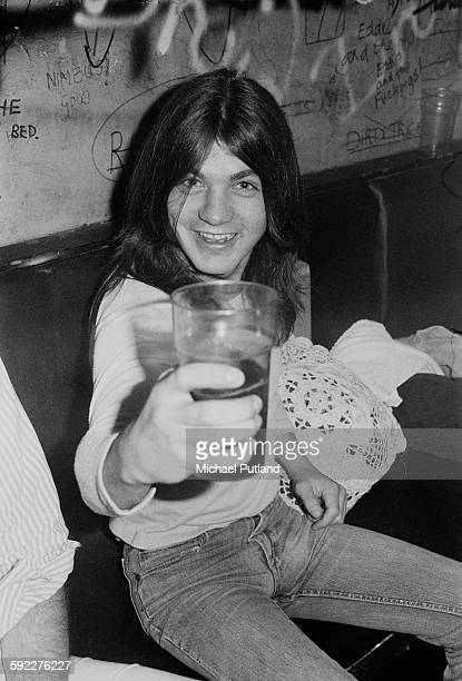 Rhythm guitarist Malcolm Young of hard rock group AC/DC backstage after a performance at the Marquee Club on Wardour Street London 11th August 1976