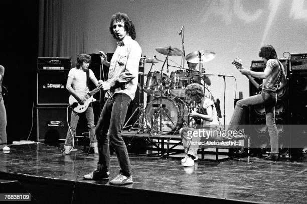 Rhythm guitarist Malcolm Young singer Bon Scott drummer Phil Rudd lead guitarist Angus Young and bassist Mark Evans of AC/DC rehearse for a gig circa...