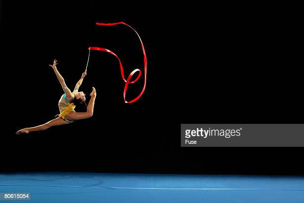 rhythmic gymnast dancing with ribbon - rhythmic gymnastics stock pictures, royalty-free photos & images