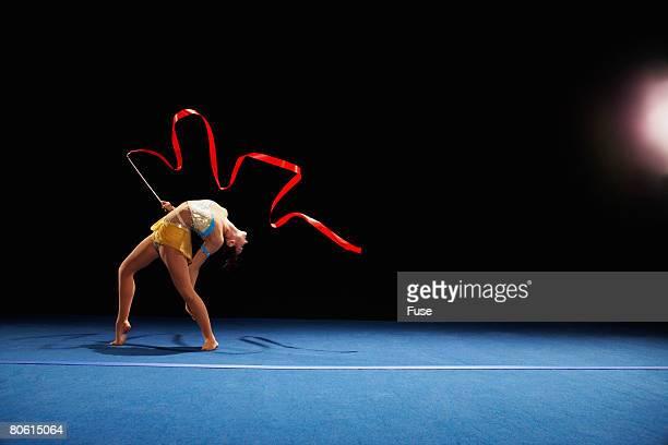 rhythmic gymnast dancing with ribbon - rhythmic gymnastics stock-fotos und bilder