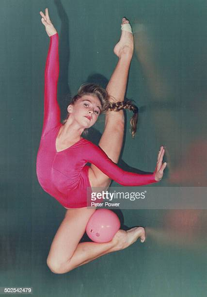 Rhythmic gymnast is all wrapped up in her work Marta Bobo 22 demonstrates the grace and flexibility required to be a top calibre rhythmic gymnast...