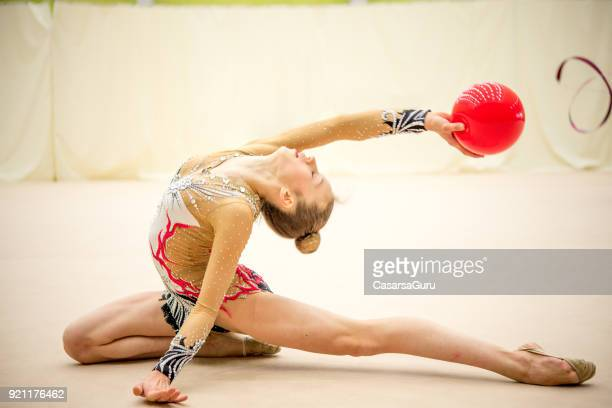 rhythmic gymnast practicing with a ball - rhythmic gymnastics stock pictures, royalty-free photos & images