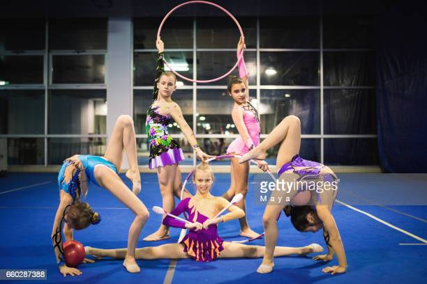 rhythmic gymnastics girls - acrobatic activity stock pictures, royalty-free photos & images