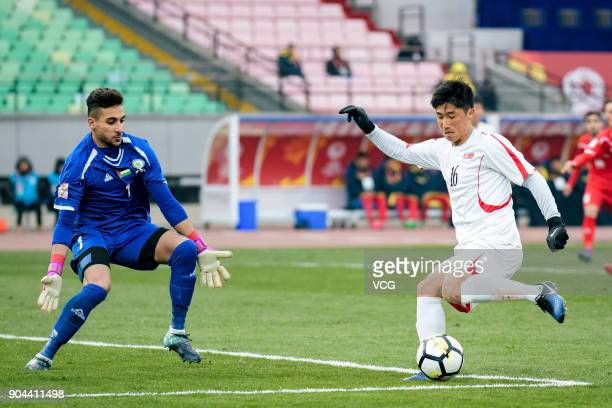 Ri Hun of North Korea kicks the ball during the AFC U23 Championship Group B match between Palestine and North Korea at Jiangyin Stadium on January...