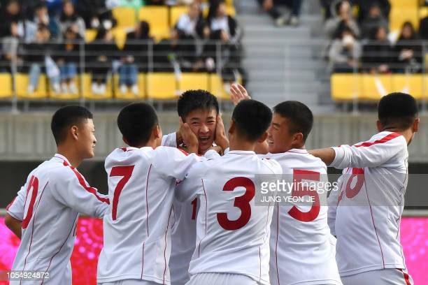 Ri Il Song of the April 25 Sports Club of North Korea celebrates scoring with his teammates against the Gangwondo team of South Korea during their...