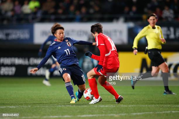 Ri Kyong Hyang#10 of North Korea and Tanaka Mina of Japan compete for the ball during the EAFF E1 Women's Football Championship between Japan and...