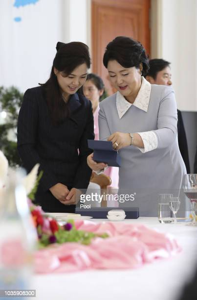 Ri Sol Ju wife of North Korean leader Kim Jong Un and Kim Jungsook the wife of South Korean President Moon Jaein talk during a lunch at the Okryugwan...