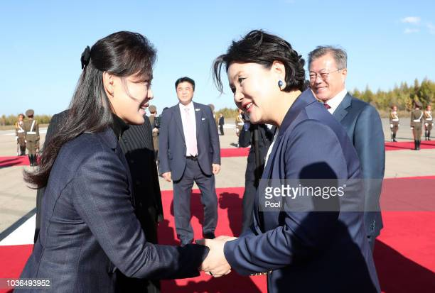 Ri Sol Ju wife of North Korea's leader Kim Jong Un bids farewell to Kim Jungsook wife of South Korean President Moon Jaein on Moon's departure at...