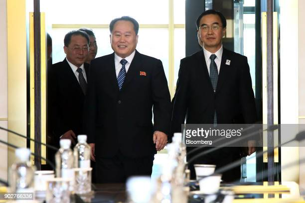 Ri Son Gwon chairman of North Koreas Committee for the Peaceful Reunification of the Fatherland center and Cho Myounggyon South Korea's unification...