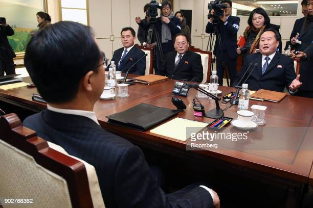 Ri Son Gwon chairman of North Koreas Committee for the Peaceful Reunification of the Fatherland seated right speaks with Cho Myounggyon South Korea's...