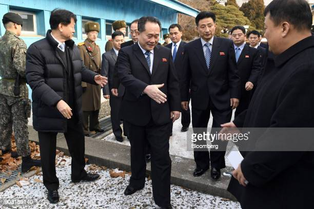 Ri Son Gwon chairman of North Koreas Committee for the Peaceful Reunification of the Fatherland center is seen greeting an attendee while visiting...
