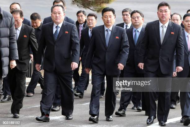 Ri Son Gwon chairman of North Koreas Committee for the Peaceful Reunification of the Fatherland front left and other North Korean delegates are seen...