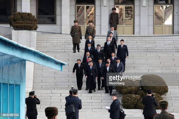 Ri Son Gwon chairman of North Koreas Committee for the Peaceful Reunification of the Fatherland front center left and other North Korean delegates...