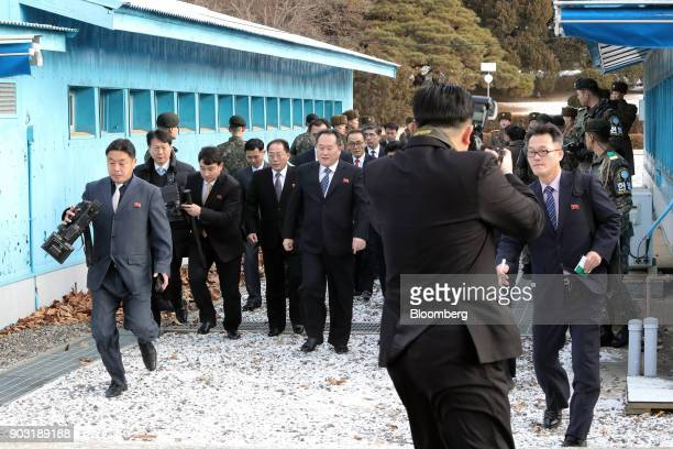 Ri Son Gwon chairman of North Koreas Committee for the Peaceful Reunification of the Fatherland center and other North Korean delegates are seen...