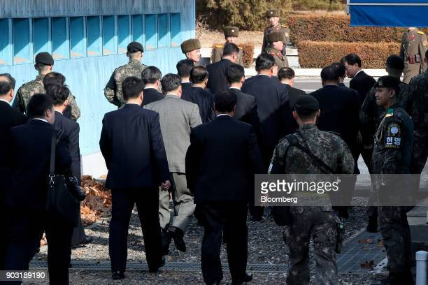 Ri Son Gwon chairman of North Koreas Committee for the Peaceful Reunification of the Fatherland center right and other North Korean delegates are...