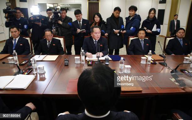 Ri Son Gwon chairman of North Koreas Committee for the Peaceful Reunification of the Fatherland seated center speaks with Cho Myounggyon South...