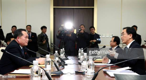 Ri Son Gwon chairman of North Koreas Committee for the Peaceful Reunification of the Fatherland seated left and Cho Myounggyon South Korea's...