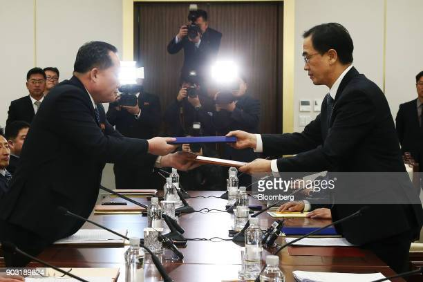 Ri Son Gwon chairman of North Koreas Committee for the Peaceful Reunification of the Fatherland left and Cho Myounggyon South Korea's unification...