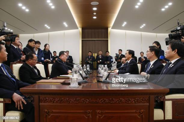 Ri Son Gwon chairman of North Koreas Committee for the Peaceful Reunification of the Fatherland seated third left and Cho Myounggyon South Korea's...
