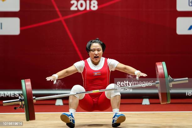 Ri Song Gum of DPR Korea fails to snatch during women's 48kg weightlifting on day two of the Asian Games on August 20, 2018 in Jakarta, Indonesia.