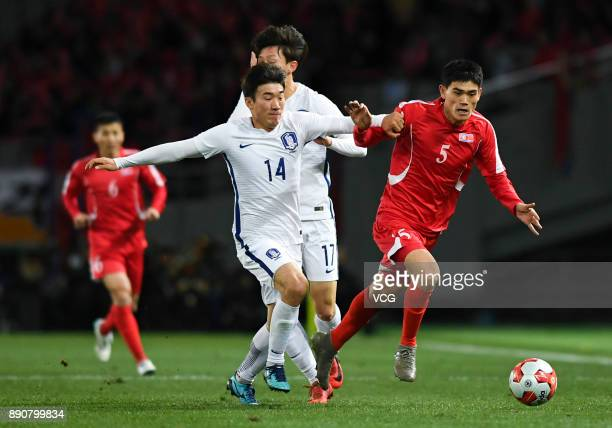 Ri Un-chol of North Korea and Go Yo-han of South Korea compete for the ball during the EAFF E-1 Men's Football Championship between North Korea and...
