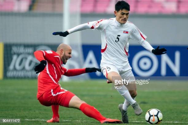Ri UnChol of North Korea controls the ball during the AFC U23 Championship Group B match between Palestine and North Korea at Jiangyin Stadium on...